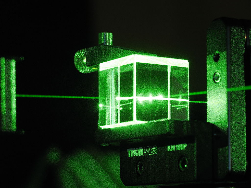 According to quantum mechanics, no one can predict whether a photon will be reflected by or transmitted through a piece of glass, not even in principle. It's fundamentally random.