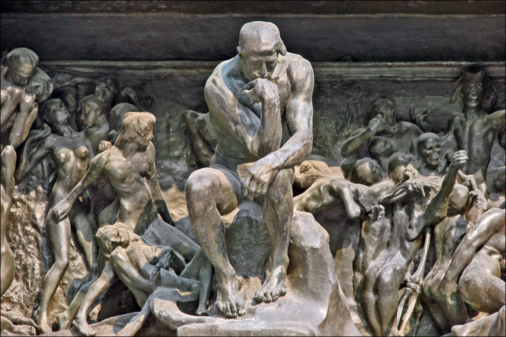 The Thinker in Auguste Rodin's sculpture The Gates of Hell. Image Credit: Wikipedia